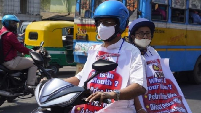 Mamata Banerjee rides an electric scooter to protest the fuel price hike - India Press Release