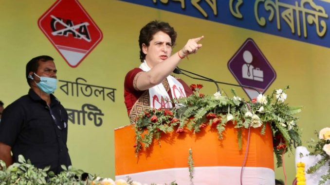 Priyanka Gandhi runs to reach the venue of rally in Assams Tezpur - India Press Release